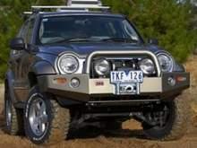 Комбинированный передний силовой бампер под лебедку (цвет: Millenium Grey) на Jeep Liberty KJ (05-07г.) можно купить в 4x4mag.ru